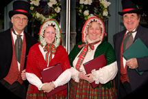 CT Yuletide Carolers singing outside